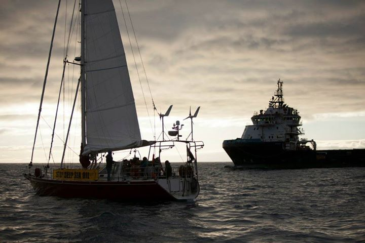 The sailing vessel Tiama in front of the drill support vessel the Hart Tide.